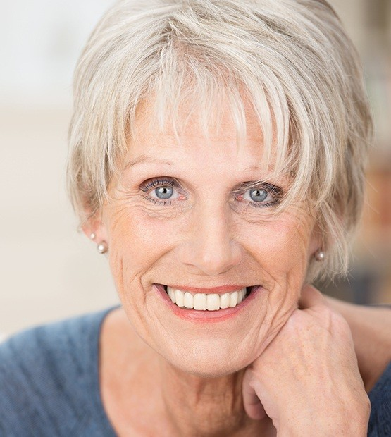 Woman showing her healthy smile with dentures