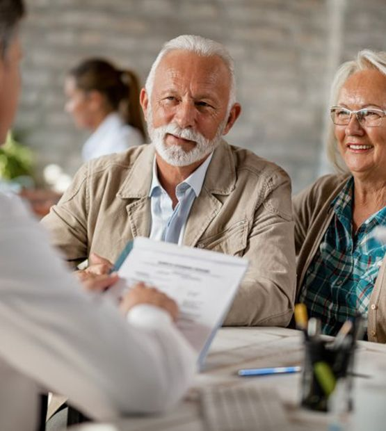 older couple attending consultation with their dentist