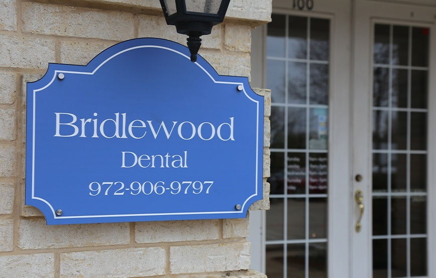 Bidlewood Dental sign on exterior of dental office building