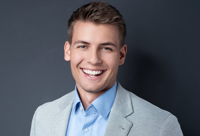 Man sharing smile perfected with porcelain veneers