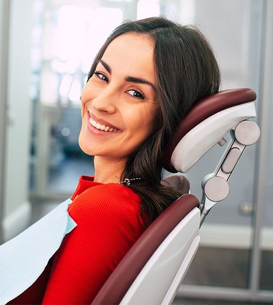 Woman at dental office for teeth whitening treatment