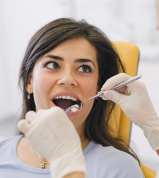Woman receiving wisdom tooth extraction