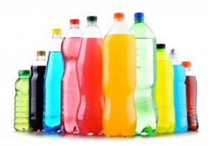Row of colorful energy and sports drinks that damage teeth
