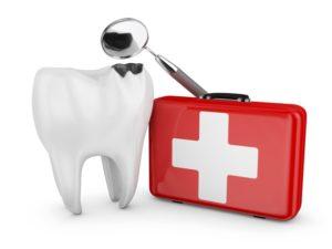 damaged tooth standing next to dental emergency kit