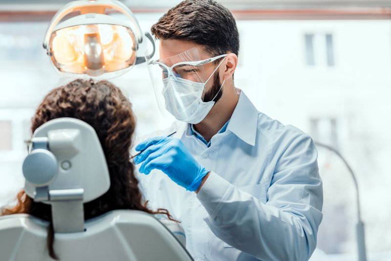 Dentist conducting a dental cleaning