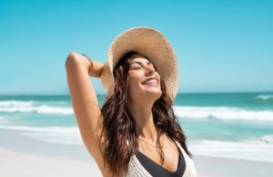 woman smiling enjoying the summer sun