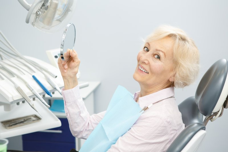 Woman smiling at the dentist with dental implants